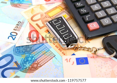 Calculator and key from the car for euro banknotes.