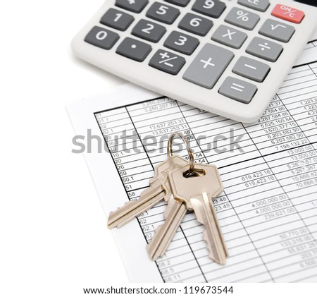 Calculator and keys on the documents. - stock photo