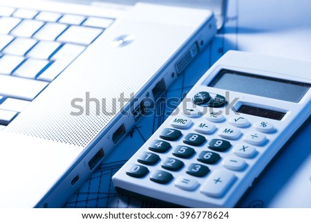 calculator and laptop close up - stock photo