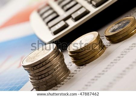 Calculator and money - stock photo