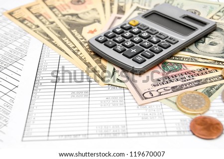 Calculator and money on the documents