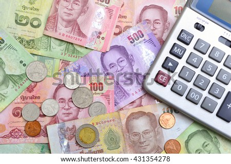 Calculator and money thai banknote. The concept of financial planning, savings. - stock photo
