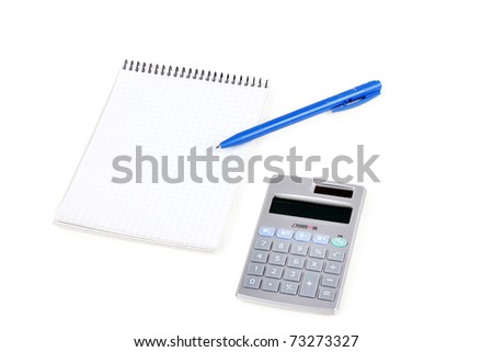 Calculator and paper notebook with blue pen, closeup on white