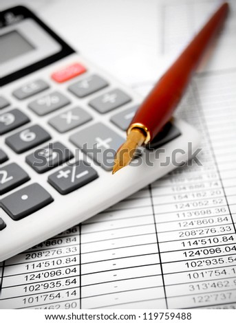 Calculator and pen on documents. - stock photo