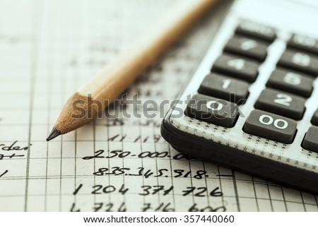 Calculator and pencil - stock photo