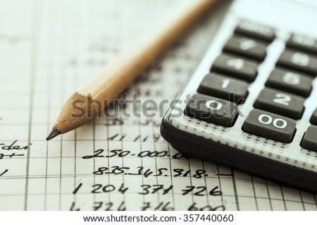Calculator and pencil - stock photo
