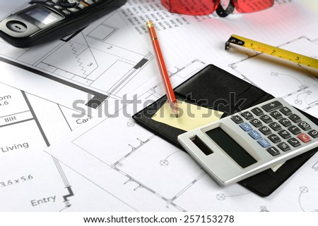calculator and pencil and measuring tape and goggles safety and telephone on table - stock photo