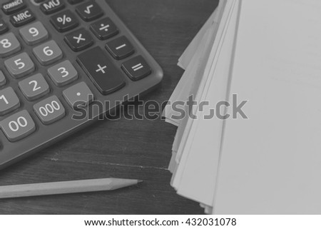 Calculator and pencil on paper.