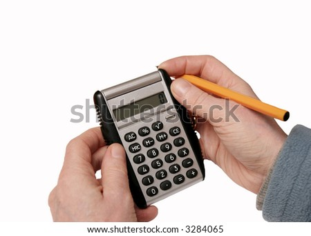 calculator and penn in hand, on isolated white background