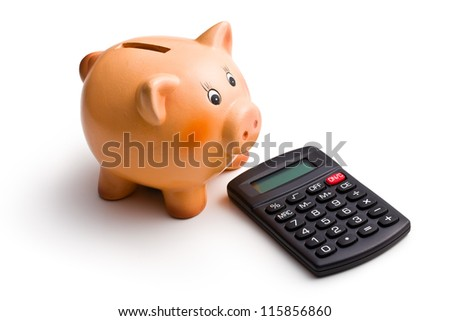 calculator and piggy bank on white background - stock photo