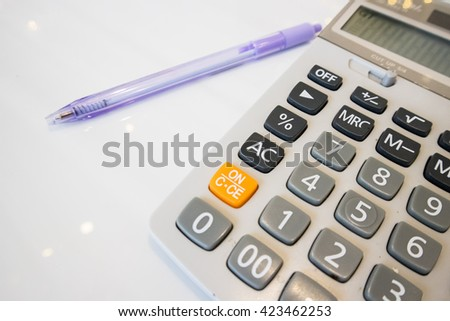 Calculator and Purple Pen