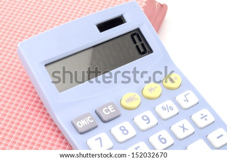 calculator and red notebook isolated on white background - stock photo