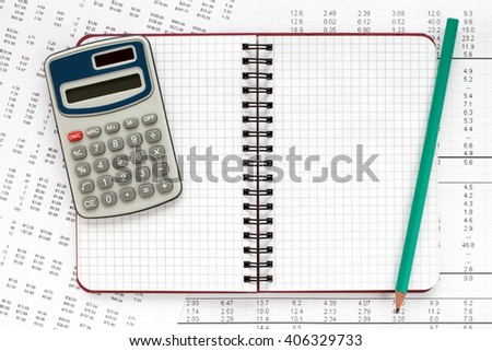 Calculator and spiral notebook on financial statement , concept of accounts.