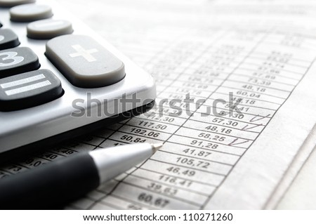 calculator and stationery items on the table - stock photo