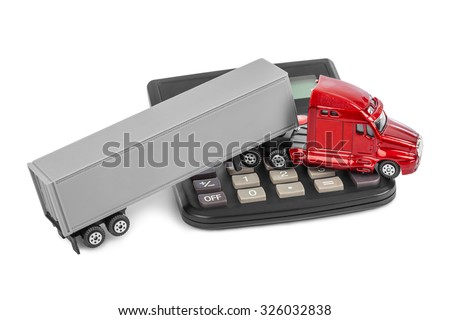 Calculator and toy truck car isolated on white background - stock photo