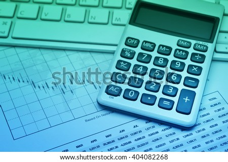 Calculator button plus on keyboard and graph paper, accounting background