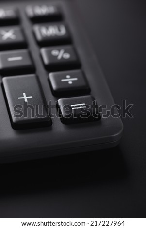 Calculator closeup. Night. Shallow depth of field. - stock photo
