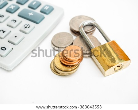 Calculator, coins and padlock on white background. Saving concept.