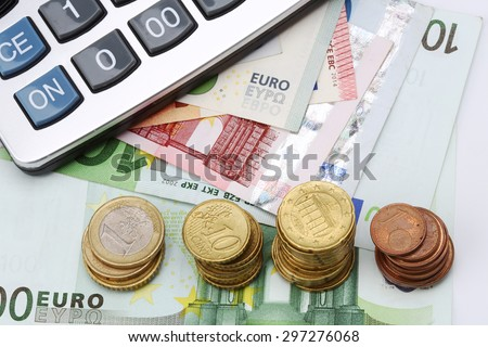 Calculator, euro bills and coins close up - stock photo