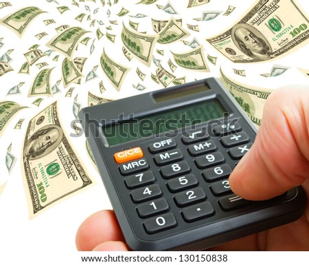 Calculator in hand on a background of flying notes. - stock photo