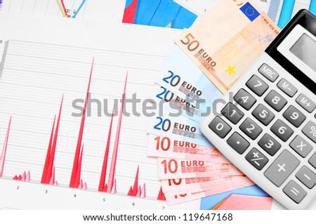 Calculator, money (euro) on graphs. - stock photo