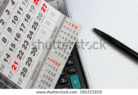 Calculator, notebook and calendar