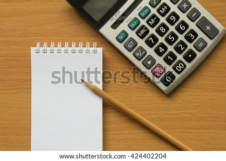 Calculator, notebook and pencil for calculate  - stock photo
