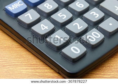 calculator number two button on a wooden.