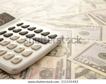 Calculator on a dollars background