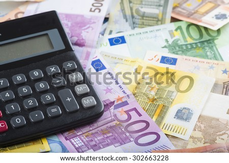 Calculator on a money background made of banknotes - stock photo