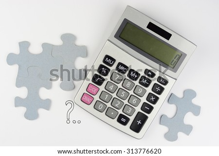 Calculator on a white grey background with question mark and puzzle pieces for finance administration - stock photo