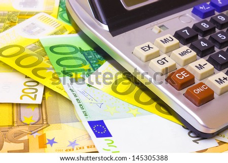 Calculator on banknotes, Value of Money, photography