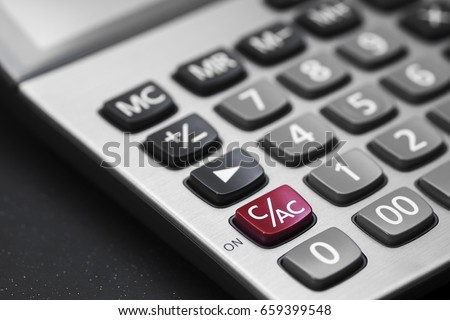 calculator on black and white on C/AC button is red color