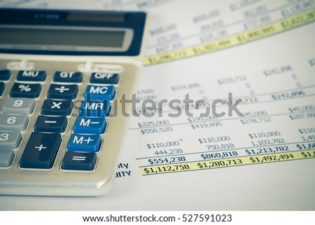 calculator on book bank with vintage tone