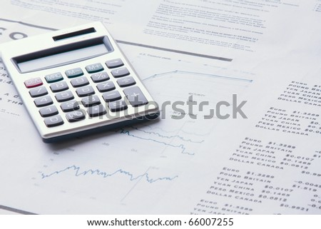 calculator on business paper - stock photo