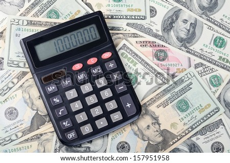 calculator on dollar background , business concept - stock photo