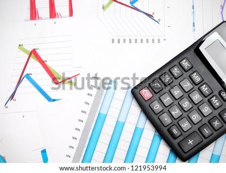 Calculator on graphs. - stock photo