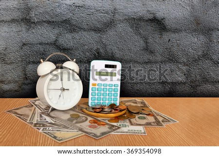 calculator on pile of banknote with dark crack wall background
