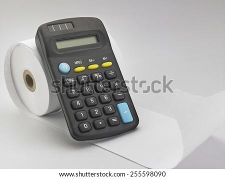 calculator on the adding tape machine - stock photo