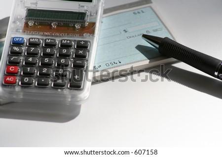 calculator, pen and checkbook - stock photo