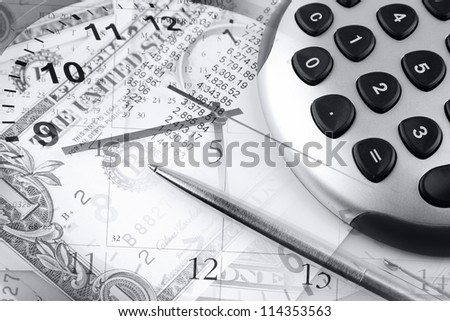Calculator, pen, clock hands and money