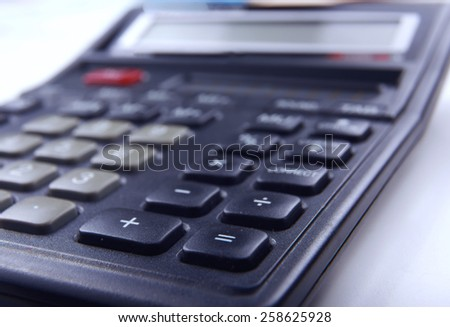 Calculator, pen, folder with documents
