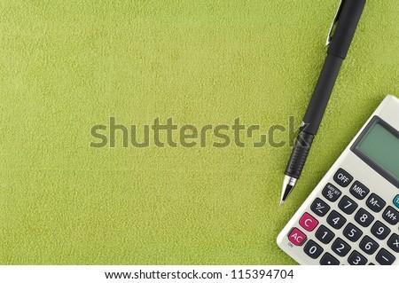 Calculator pen on fabric - stock photo