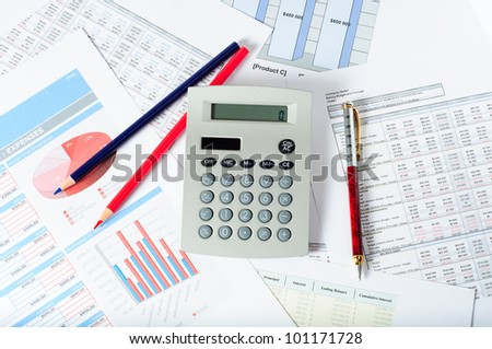 calculator pencils and pen over financial documents - stock photo