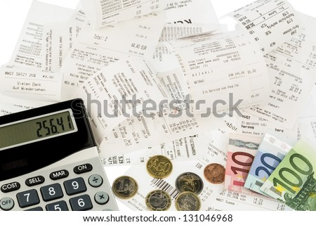 calculator, receipts and money symbol photo for savings, purchasing power and inflation - stock photo