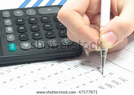 Calculator, spreadsheet and hand writing - stock photo