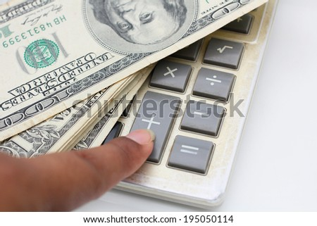 Calculator with dollar  - stock photo