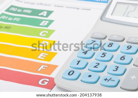 Calculator with energy efficiency chart - stock photo
