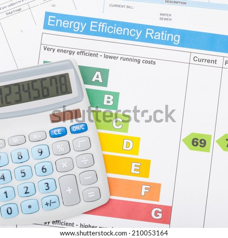 Calculator with energy efficiency chart - 1 to 1 ratio - stock photo