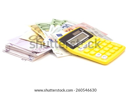 Calculator with euro bank notes isolated - stock photo